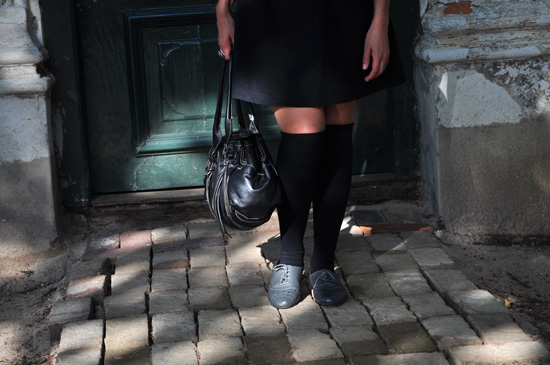 Black leather bag, OTK socks, grey brogues